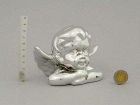 Figūrėlė-dekoracija angelo formos, keramikinė, sidabro sp., 13 x 8,5 x 9 cm.
